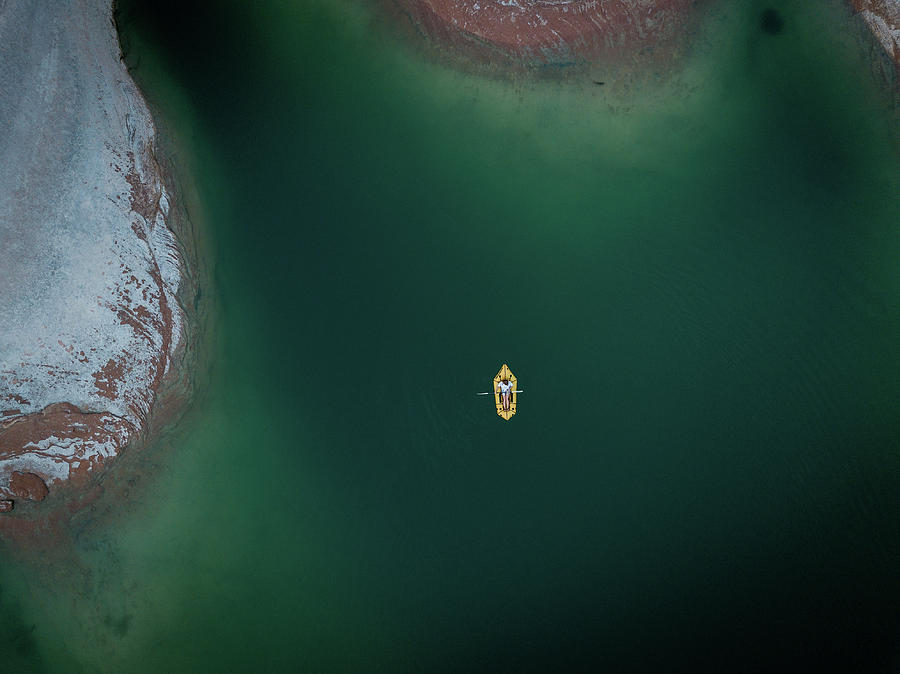 Yellow Boat, green water, red rock by Ryan Lima