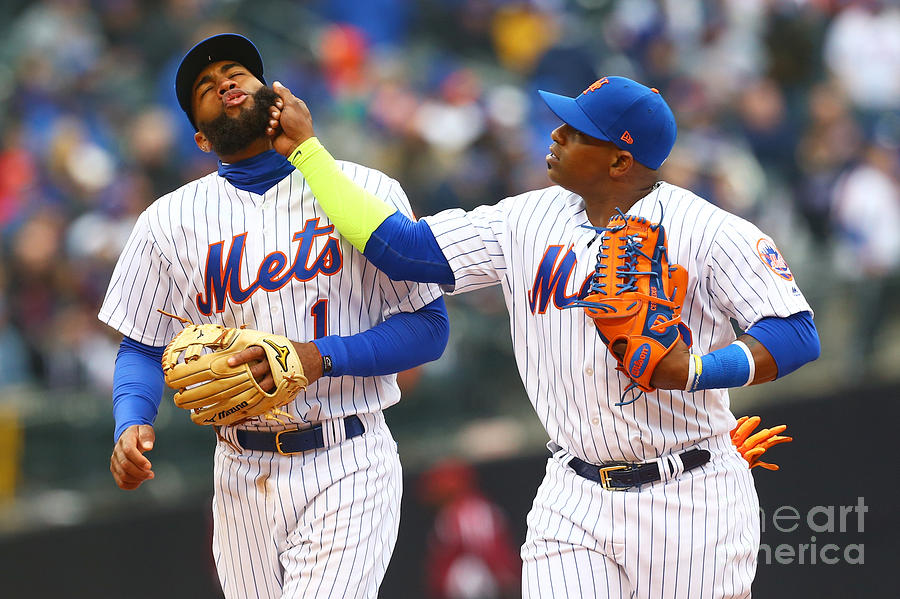 Yoenis Cespedes and Amed Rosario Photograph by Mike Stobe
