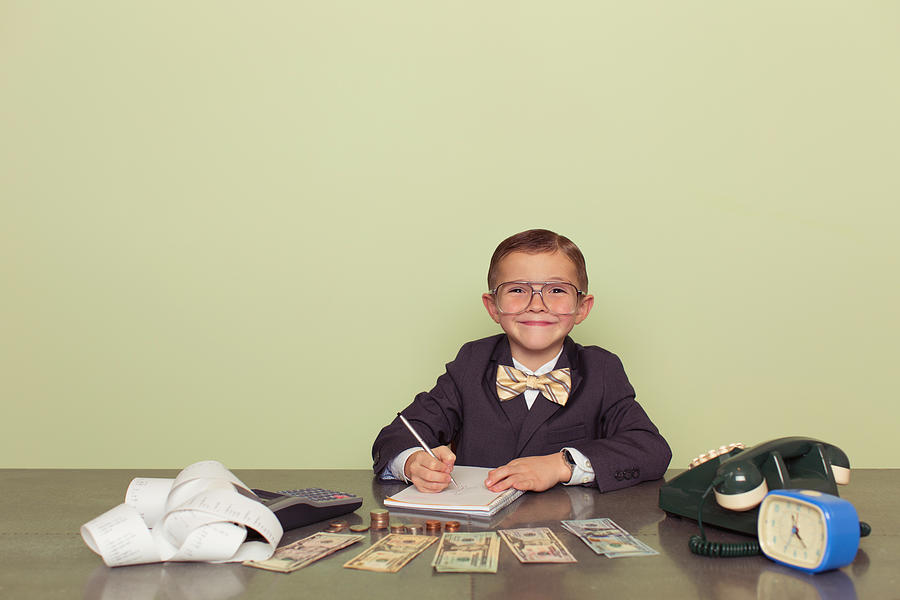 Young Boy Accountant Records Taxes to be Paid Photograph by Andrew Rich