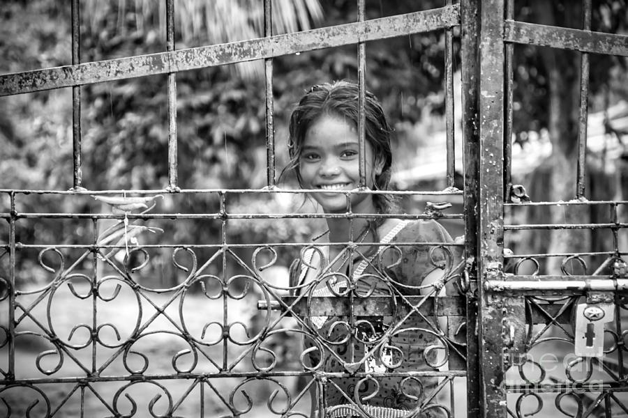 Innocence Photograph - Young Indian Smile - Street beautiful girl portrait black and white by Stefano Senise