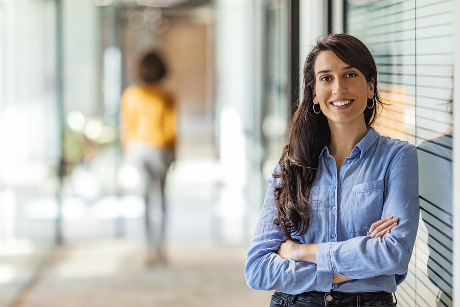 Young mixed race businesswoman smiling to camera Photograph by Ljubaphoto