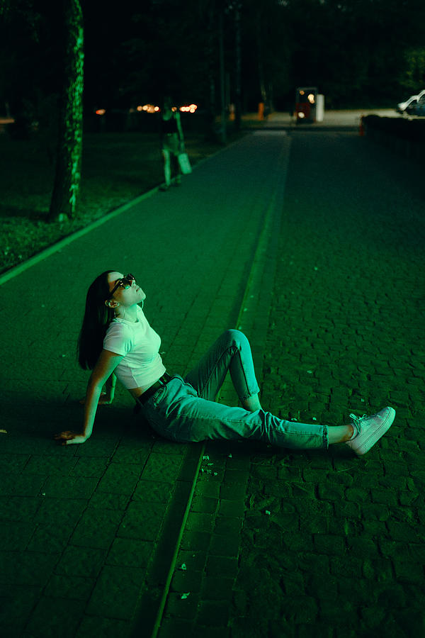 Young woman in sunglasses in neon lighting Photograph by Masha Raymers
