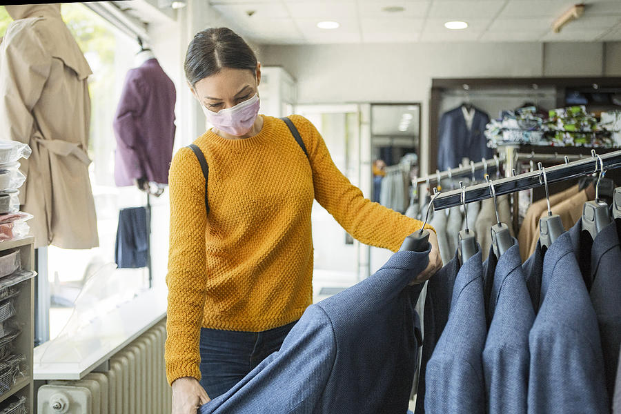 Young woman shopping at the time of virus wearing protective mask Photograph by Nastasic