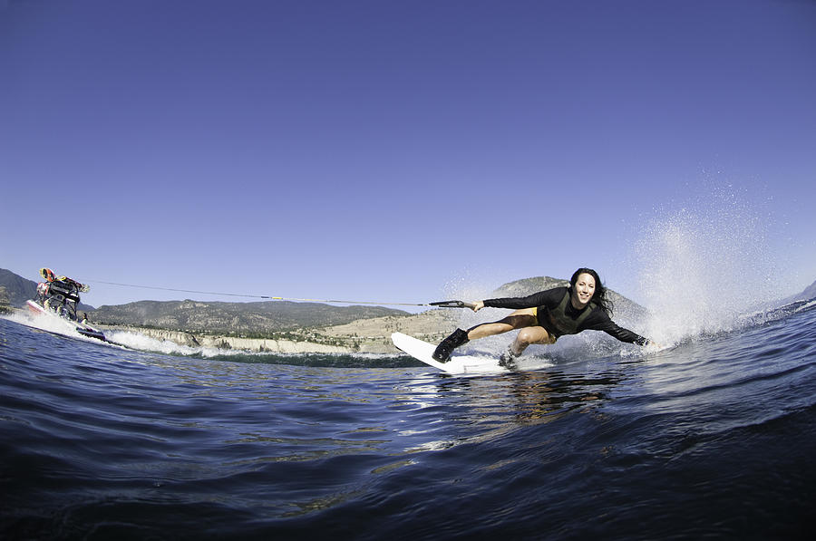 Young Woman Wakeboarding Photograph by Darryl Leniuk