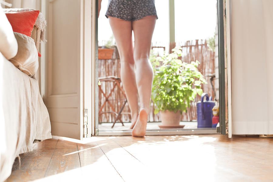 Young Woman Walking On Her Balcony Photograph by Westend61