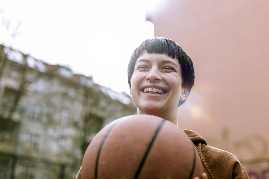 Young Woman With Basketball Photograph by Hinterhaus Productions