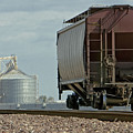 A Lone Grain Hopper Stands Idle On The Tracks by Mark Hendrickson