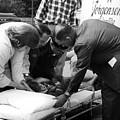 Ambulance Personnel Placing Girl Gurney April by Mark Goebel