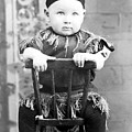 Boy Dressed Elf Sitting Backwards In Chair 1890s by Mark Goebel