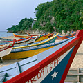 Colorful  Fishing Boats On Crashboat Beach by George Oze