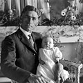 Man Male Holding Baby 1910s Black White Archive by Mark Goebel