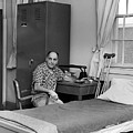 Patient Sitting Desk In Hospital Room Circa 1960 by Mark Goebel
