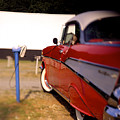 Red Chevy At The Drive-in by Robert Ponzoni