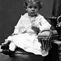 Toddler Sitting In Chair 1890s Black White Boy by Mark Goebel