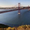 25th Of April Suspension Bridge In Lisbon by Andre Goncalves