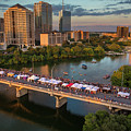 A Beautiful Sunset Falls On The Austin Skyline As Thousands Of Bat Watchers Line The Congress Avenue Bridge During The Annual Bat Fest To Watch The Bats Take Flight by Austin Welcome Center