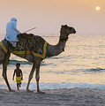 Little Boy Stares In Amazement At A Camel Riding On Marina Beach In Dubai, United Arab Emirates -  by Alexandre Rotenberg