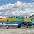 A Romanian Air Force Mig-21b Airplane by Giovanni Colla