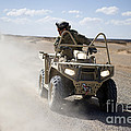 A U.s. Soldier Performs Off-road by Stocktrek Images