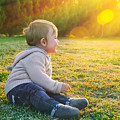 Adorable Baby Playing Outdoors by Anna Om