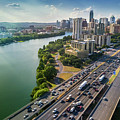 Aerial View Of The Austin Skyline As Rush Hour Traffic Picks Up On I-35 by Austin Welcome Center