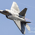 An F-22a Raptor Of The U.s. Air Force by Rob Edgcumbe