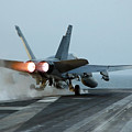 An Fa-18 Hornet Launches by Stocktrek Images