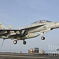 An Fa-18e Super Hornet Makes An by Giovanni Colla