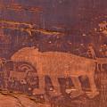 Ancient Native American Petroglyphs On A Canyon Wall Near Moab. by Jim Thompson