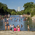 Austinites Love To Lounge In The Refreshing Waters Of Barton Springs Pool To Beat The Sizzling Texas Summer Heat by Austin Welcome Center