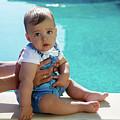 Baby Boy Sitting By The Pool by Elena Saulich