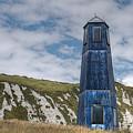 Blue Lighthouse by Mickey At Rawshutterbug