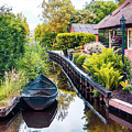 Bridge And River In Old Dutch Village by Ariadna De Raadt