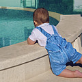 Child In A Denim Suit Sits by Elena Saulich