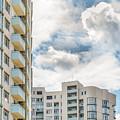 Clouds And Buildings by Alain De Maximy