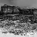 Courthouse Butte And Bell Rock Under Snow by Alexey Stiop