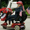 Patriotic Lady On A Scooter by Carl Purcell