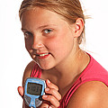 Diabetic Child With Blood Glucose Tester by Ted Kinsman
