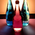 Electric Light Through Bottles by Caroline Peacock