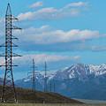 Electric Power Transmission Pylons On Inner Mongolia Grassland At Sunrise  by Oleg Yermolov