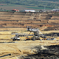 Excavators Working On Open Pit Coal Mine by Goce Risteski
