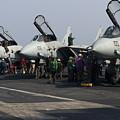 F-14d Tomcats On The Flight Deck Of Uss by Gert Kromhout