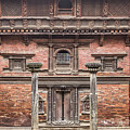 Facade Of An Ancient Traditional Newar Building In Patan Durbar  by Didier Marti