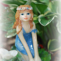 Fairy In Flowerbed by Lila Fisher-Wenzel