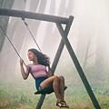 Girl In Swing by Carlos Caetano