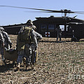 Green Berets Move A Simulated Casualty by Stocktrek Images