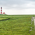 Green Fields And Romantic Lighthouse by JR Photography