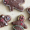 Handmade Decorated Gingerbread People Lying On Wooden Table by Michal Bednarek