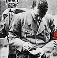 Hitler And Goebbels As The German Chancellor Signs An Autograph by David Lee Guss