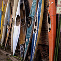 Kayaks Lined Up On Wall by Steve Clouser